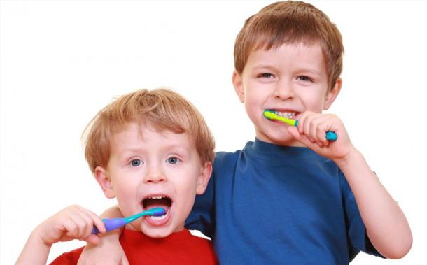 toddlers brushing teeth